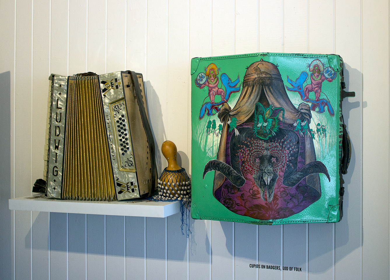 Cupids on Badgers (2019) oil on accordion case + actual Ludwig accordion by David Le Fleming