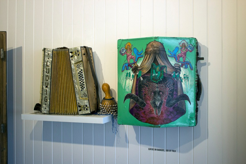 Cupids on Badgers – God of Folk (2019) – oil on accordion case – 450 x 490 x 240mm